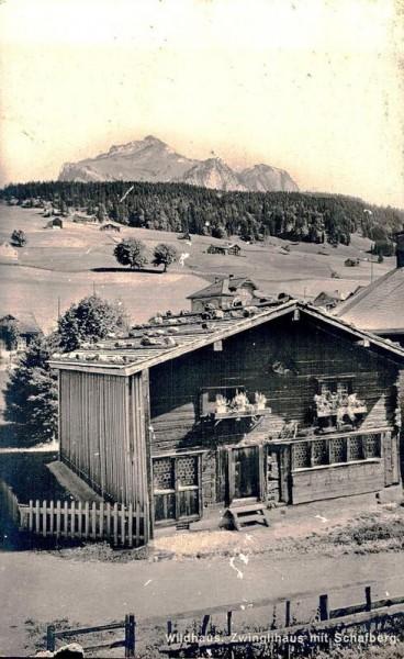 Wildhaus. Zwinglihaus mit Schafberg Vorderseite